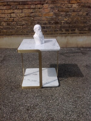 Satin brass and Cararra marble side table.